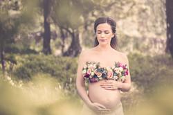 Gravid i blomstertopp