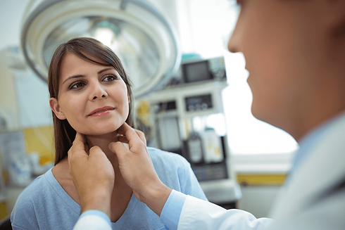 woman-getting-thyroid-checked-by-doctor.