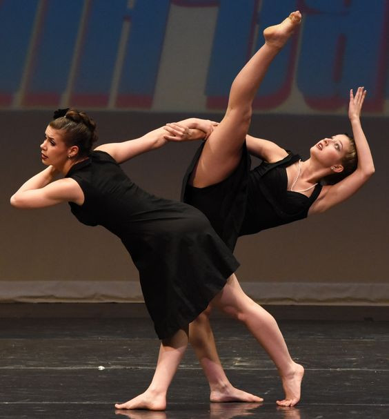 Two dancers leaning on each other