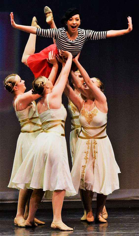Dancers lifting a girl in the air