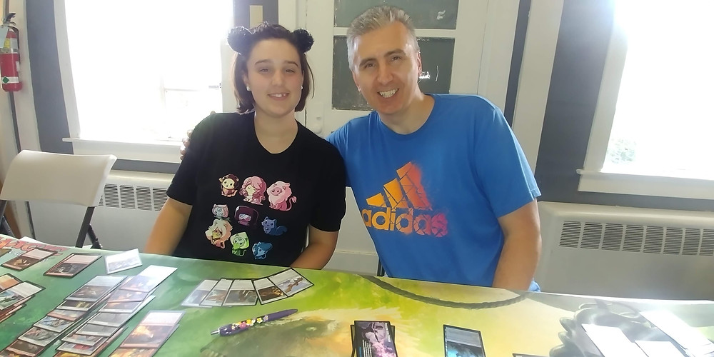 Father and daughter with cards in front of them