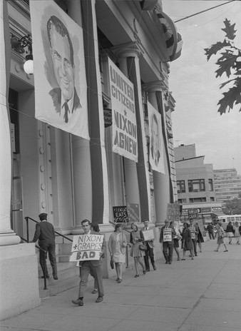 United Farm Workers supporters picket the campaign headquarters of Richard Nixon and Spiro Agnew protesting the candidates' opposition to the union and demanding that the federal minimum wage apply to farm workers. 1968.