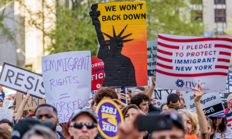 A placard reading 'Immigrant rights = workers' rights' is seen as immigrants, workers and activists march in New York City on 1 May 2017. Photograph: Erik Mc G/PacificPress/Barcroft
