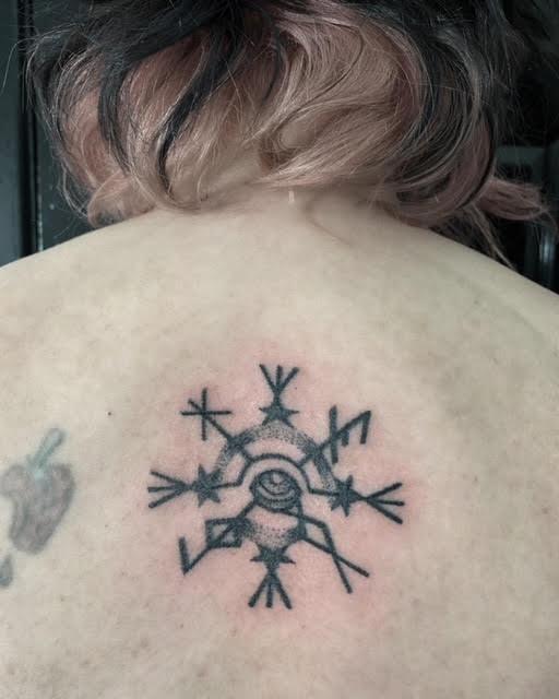 rune stave helm of awe evil eye tattoo by alexandra godwin handpoked