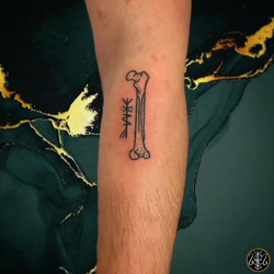 rune stave femur bone handpoke tattoo your place to space axel handfolk alexandra godwin glasgow