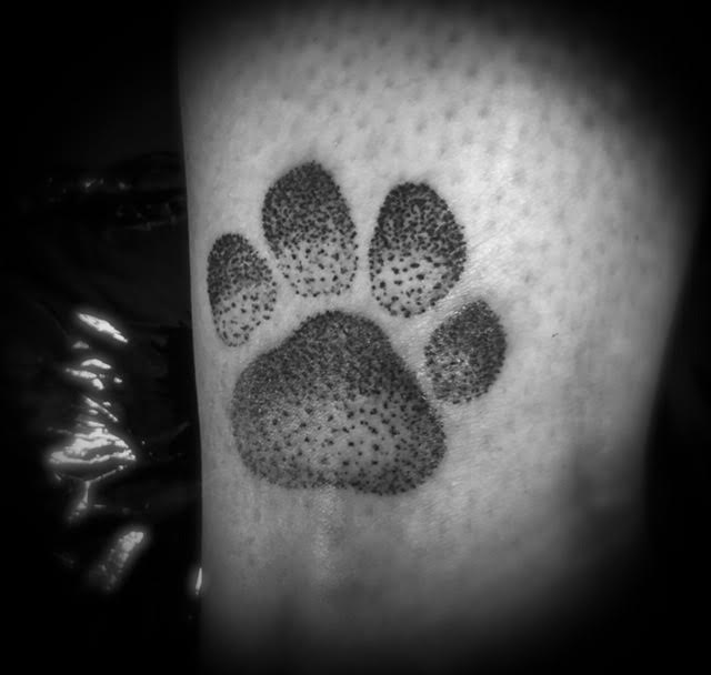 paw print stippled tattoo Your Place To Space tattoo work by Alexandra Godwin