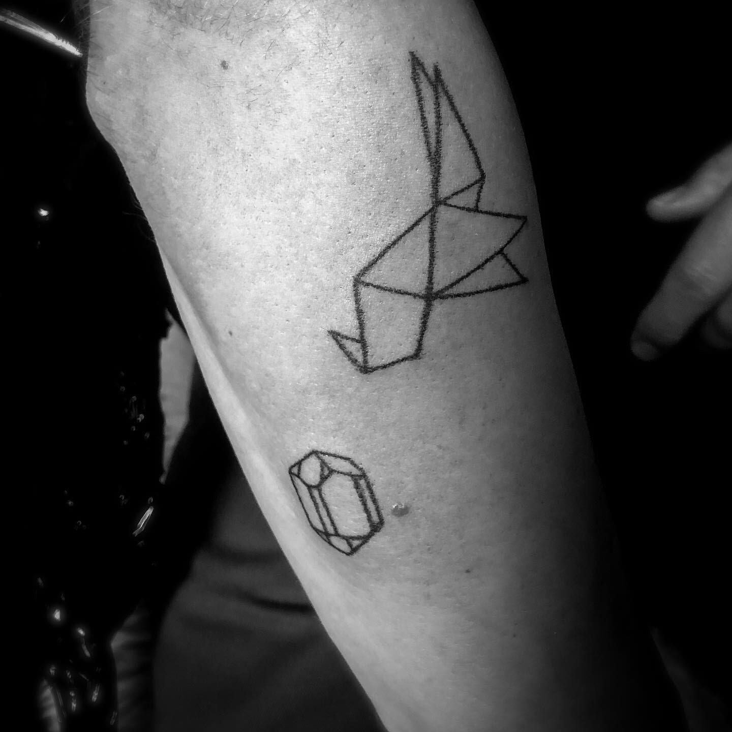 Origami crane and line jewel Your Place To Space tattoo work by Alexandra Godwin