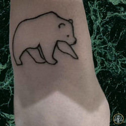 handpoked outline bear tattoo outer wrist axel handfolk your place to space