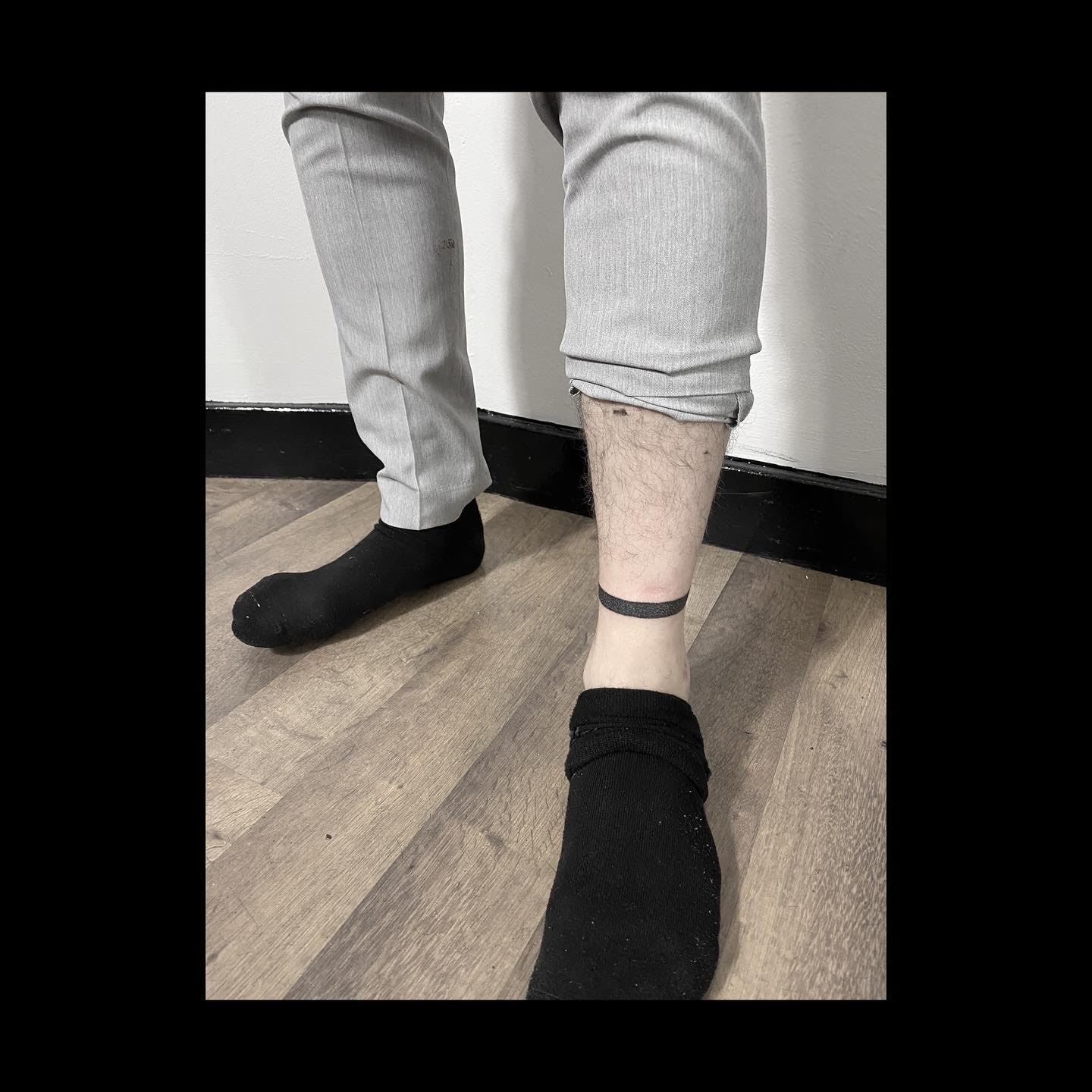 ankle line band tattoo handpoked by alexandra godwin your place to space