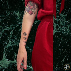 moon phases handpoked tattoo wrist piece your place to space axel handfolk