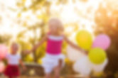 Little girl laughing with ballons