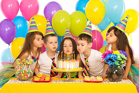 Children celebrating birthday cake at Kidz Planet Playground
