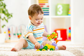 Kid Playing with Toys at Kidz Planet Playground