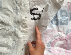Lay out your new plastic bags as you did the first and overlap them on top and bottom of your first bag.