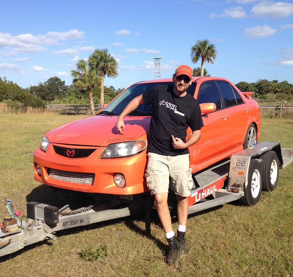 SCL Racings new Rally Mazda Protege being picked up in Orlando