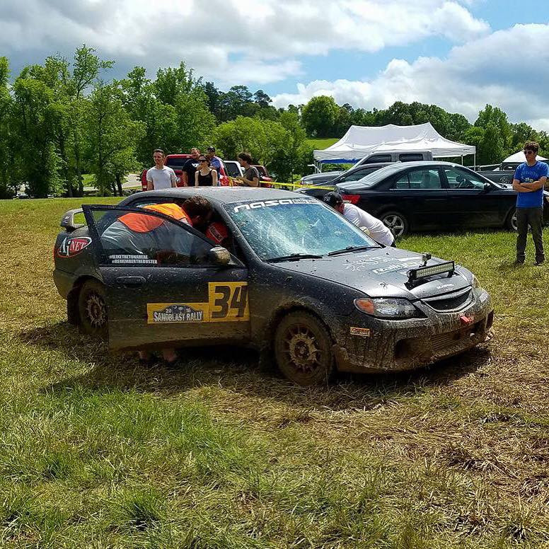 SCL Racing Rally Mazda Protege giving spectators rides at Hyperfest