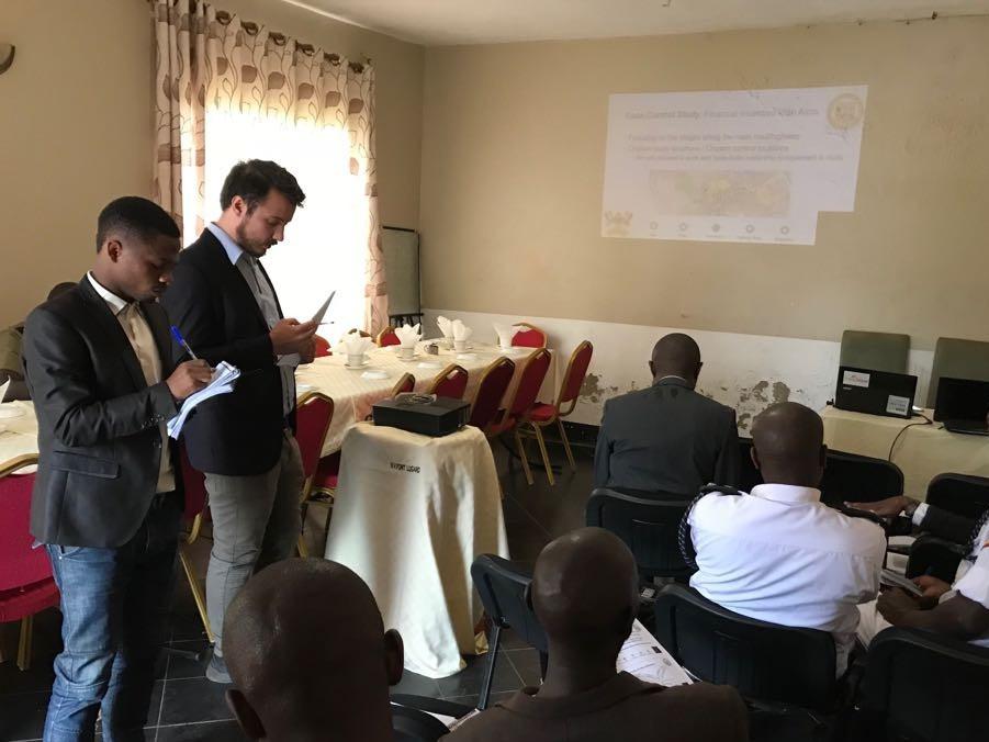Kazungu & Scott presenting research findings in Uganda