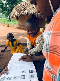 Kazungu doing field research