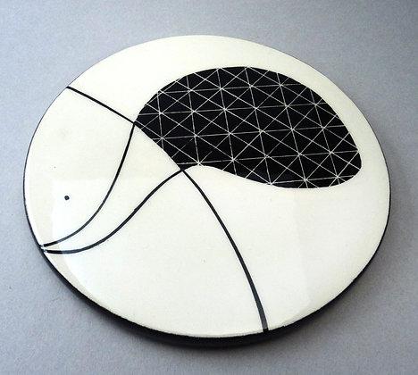 sous-plat rond noir blanc graphismes géométriques en céramique