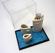 Sculpture têtes blanches en boîtes, modelages en céramique