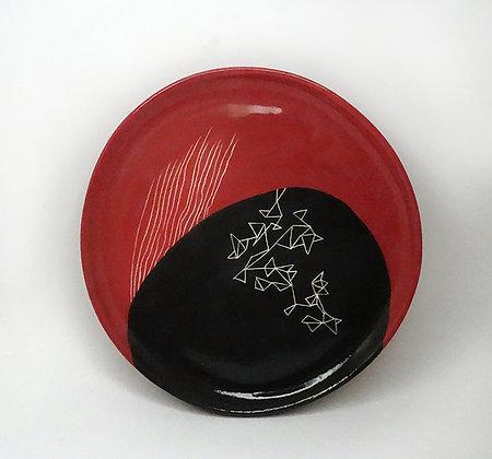 assiette de créateur ronde avec design graphique contemporain original