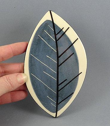 carreau décoratif bleu en forme de feuille arbre design céramique original