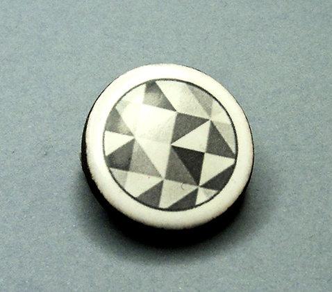 Petite broche ronde noir et blanc graphique motif vasarelli