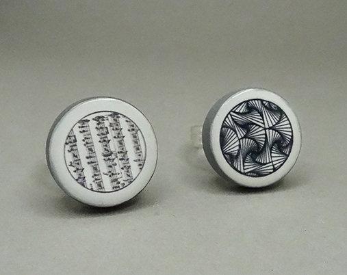 bagues rondes design noir blanc style Vasarely et partition musique