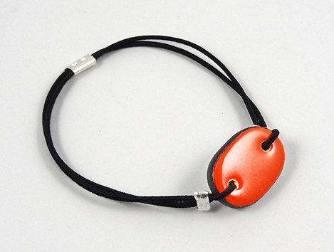 petit bracelet ovale coloré orange clair en céramique réglable