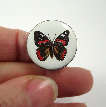 bague ronde blanche et motif papillon en céramique de créateur