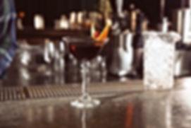 Fresh alcoholic Manhattan cocktail on ba