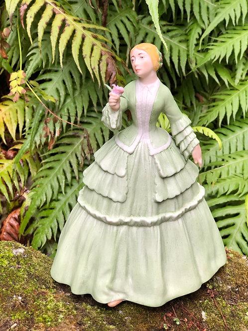 Dama con flor. Porcelana  J.G. Decorada a mano.