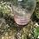 Thumbnail: Licorera de cristal color rosa.