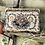 Thumbnail: Bolso de tapicería con asa dorada.