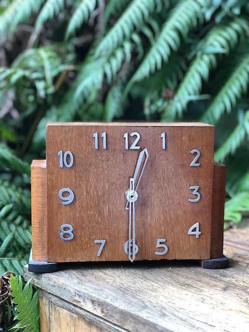 Reloj de madera Art Decó