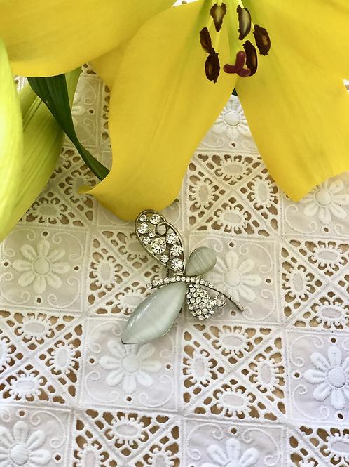 Broche mariposa.