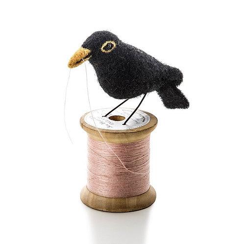 Bird on a bobbin - blackbird