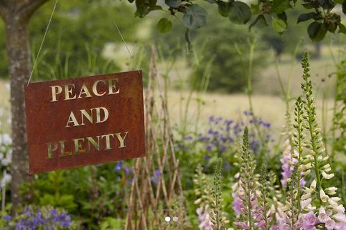 """Peace and Plenty"" rusty sign"