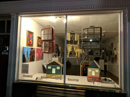 """""""Living Out of a Suitcase"""" window installation by Robert Lach"""
