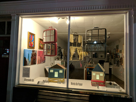 """Living Out of a Suitcase"" window installation by Robert Lach"
