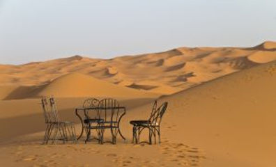 Chairs-and-table-in-a-Desert-1-300x182.j