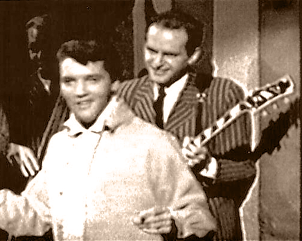 Elvis Presely and Del Casher on the set of Roustabout