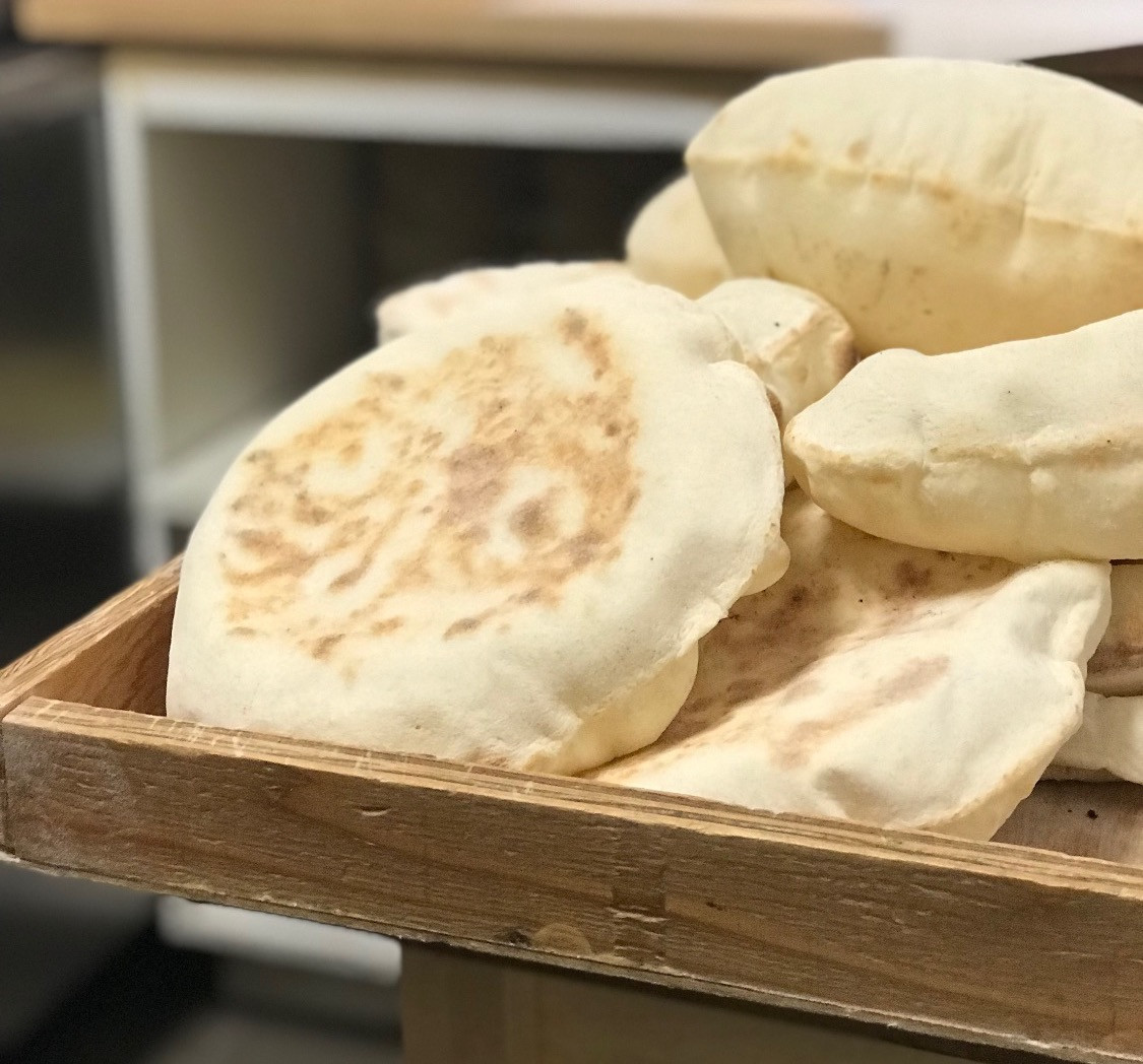 Freshly baked pita bread with your Hummus!