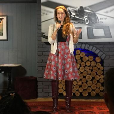 Inspired Stage, Speaker, stage, long hair, black dress, microphone