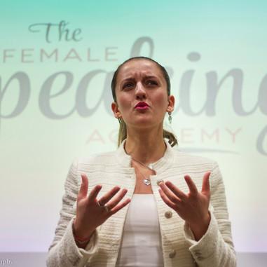 Woman, speaker, white blazer, the female speaking academy