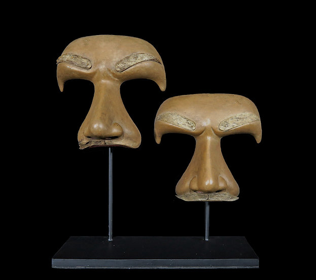 A pair of rare and unusual minimalist masks