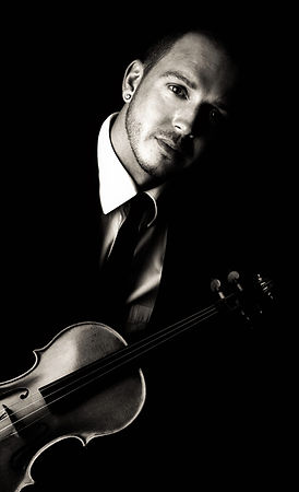 Classical violinist Craig Halliday with his 1910 German violin