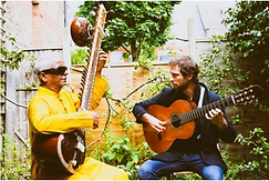 Ignatio Lusardi Monteverde and Baluji Shrivastav in the garden playing guitar and sitar