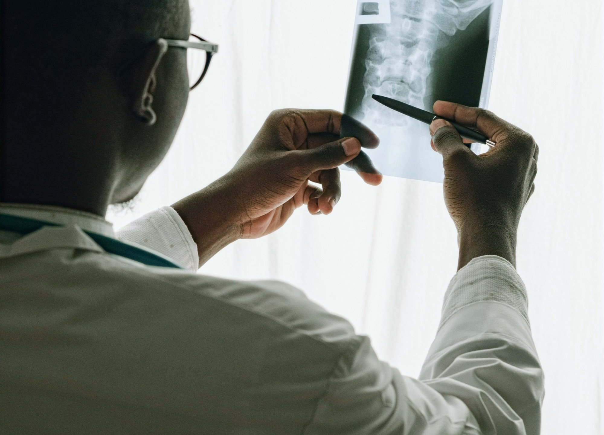 Doctor examining an x-ray from a patient