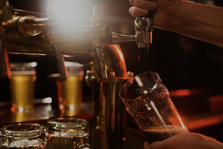close-up-bartender-pouring-beer_small_ed